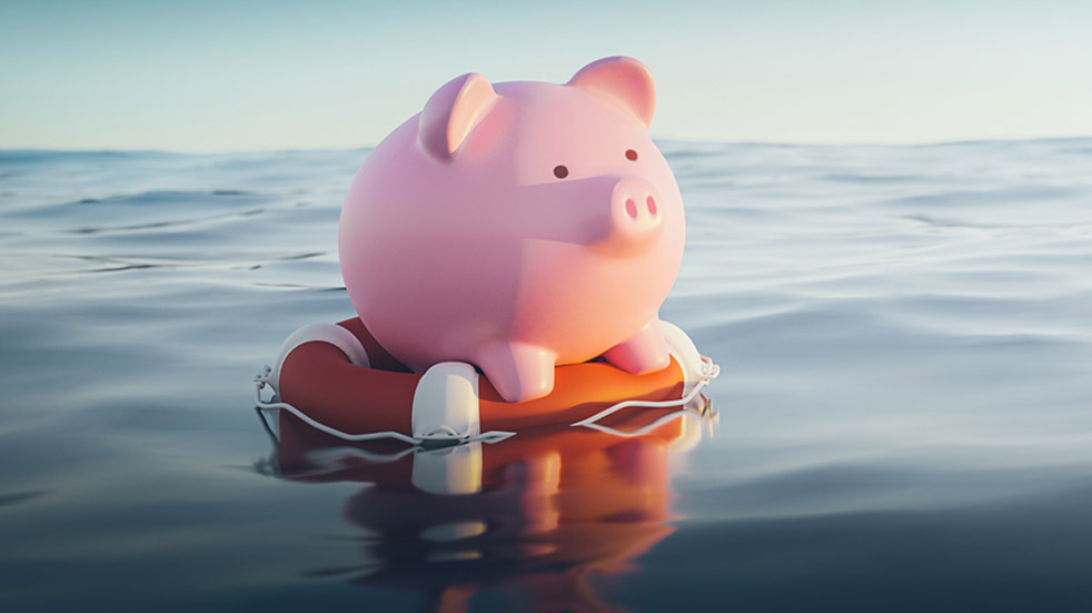 How to manage your money in a crisis piggy bank