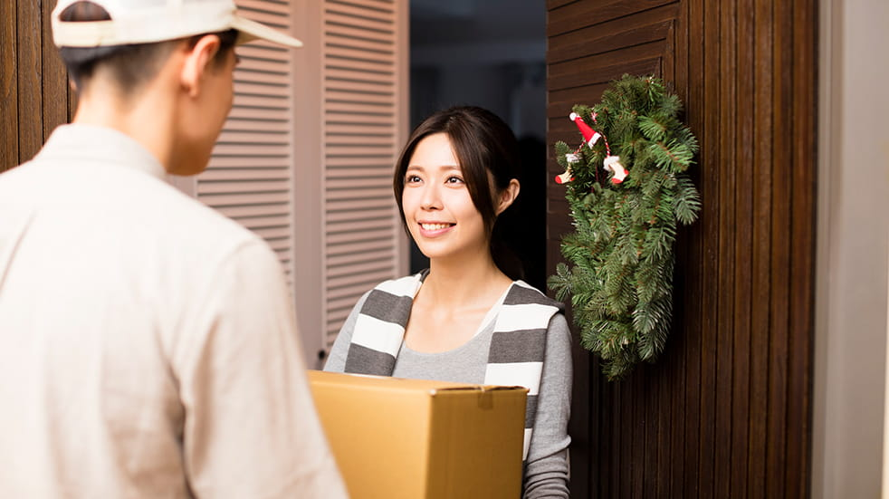 How to save money on Christmas: a Christmas parcel being delivered