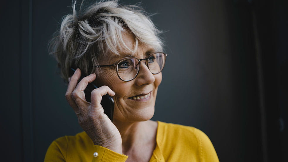 How to volunteer this Christmas smiling woman on phone