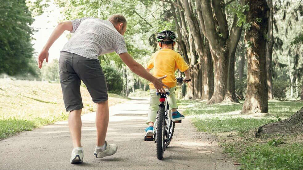 How to start family cycling - boy learning to ride a bike