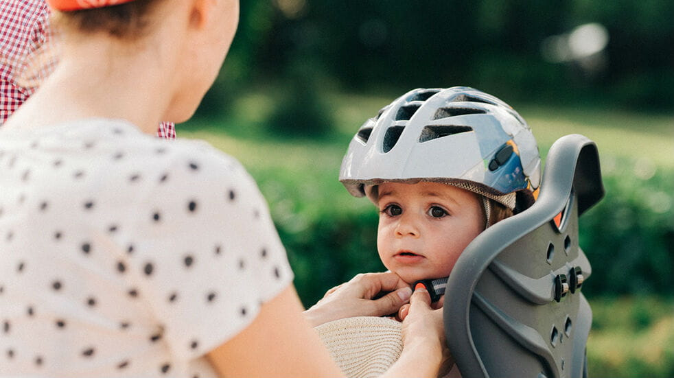 How to start family cycling - boy on a child's bike seat