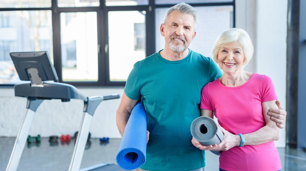 Joining a gym senior couple gym