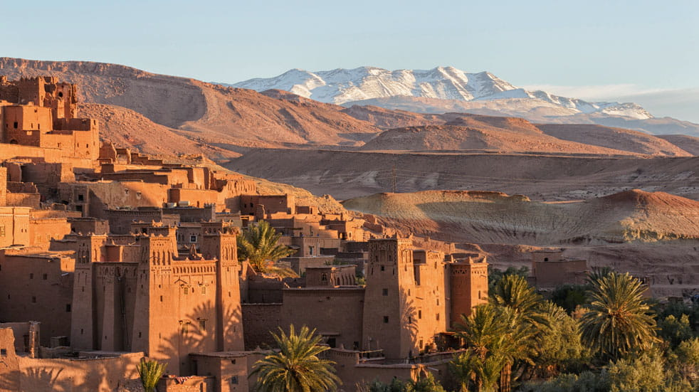Morocco's Atlas Mountains rise majestically behind Ait Benhaddou Kasbah
