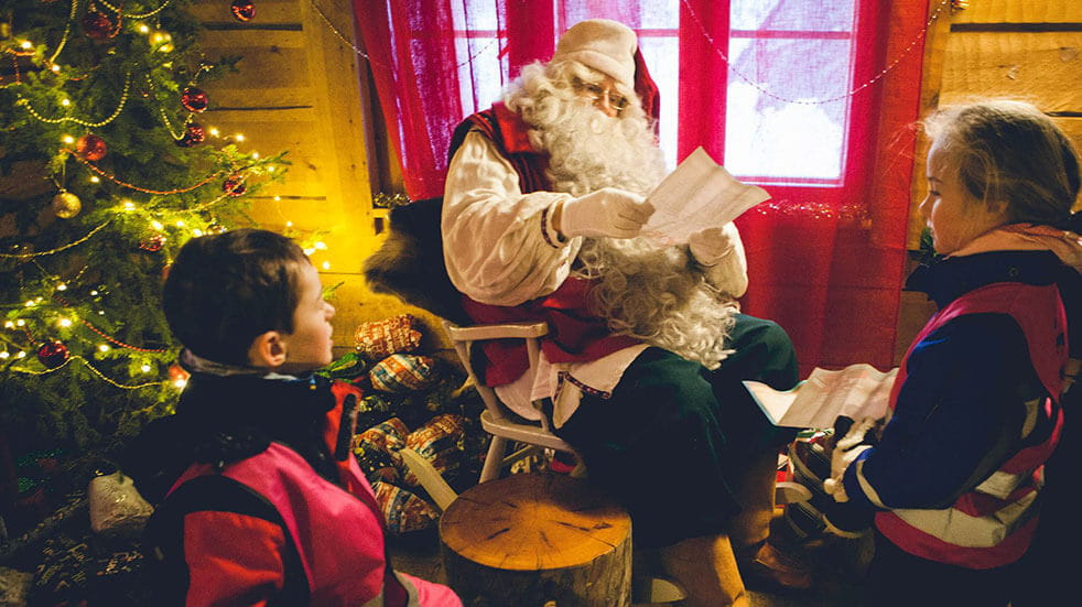 Santa's Lapland: Santa reading Christmas wish lists