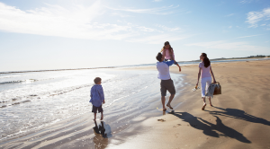 Summer holiday ideas: family on beach