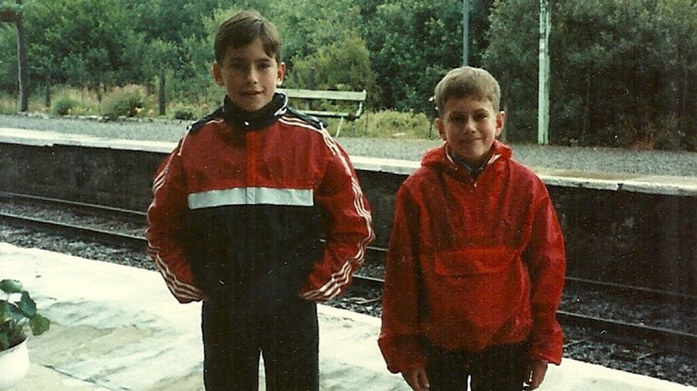 Simon Reeve as a young boy with his brother