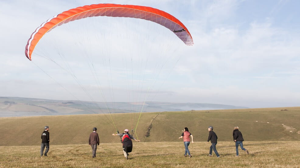 Paragliding take off from a hilltop