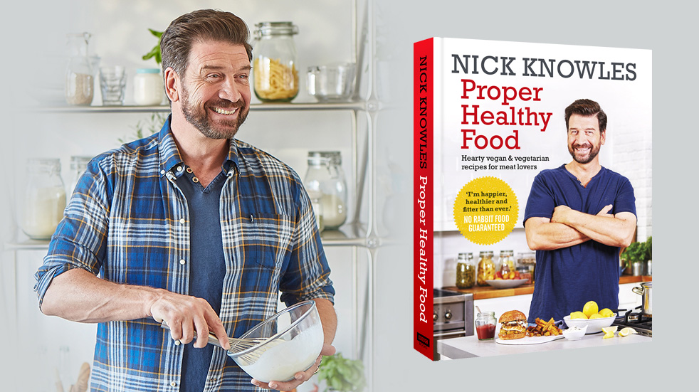 Nick Knowles cooking with an image of his book next to him