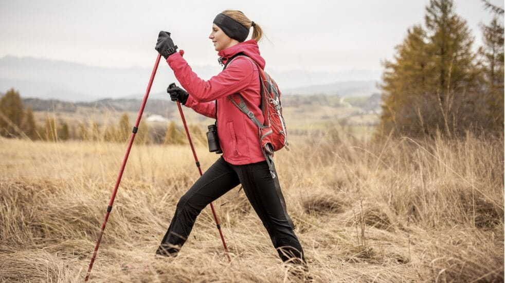 A woman Nordic walking through the countryside