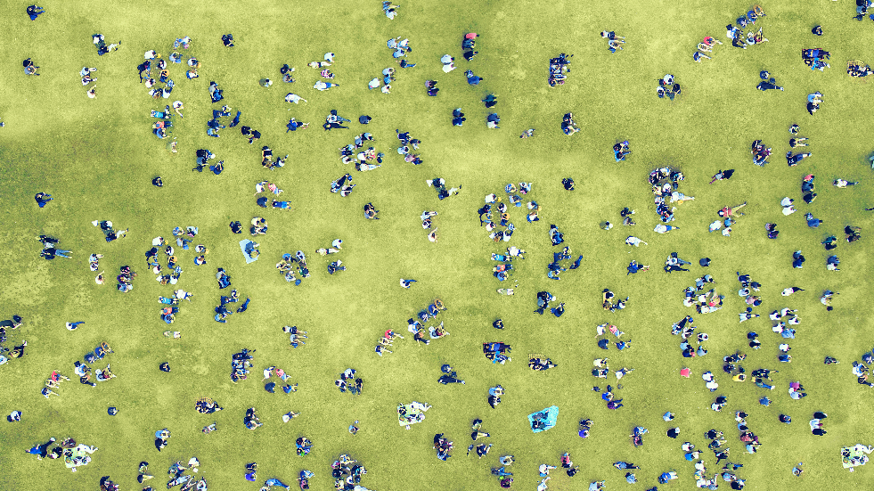 People laying around in a park from above