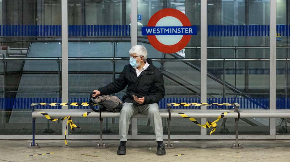 Public transport guidelines man sitting London Underground