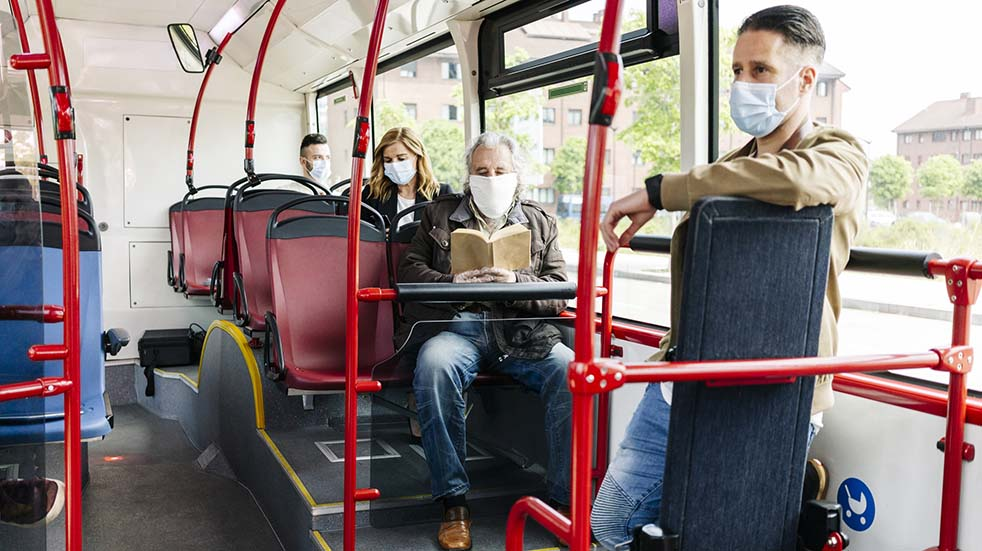Public transport guidelines people on bus face masks