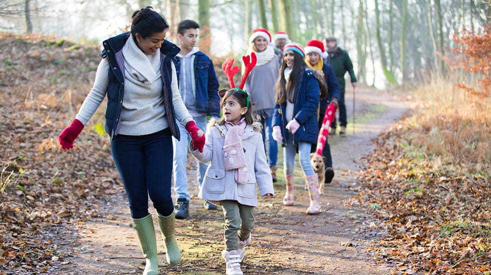 The Ramblers' Winter Walking Festival: large family group on a walk in a forest