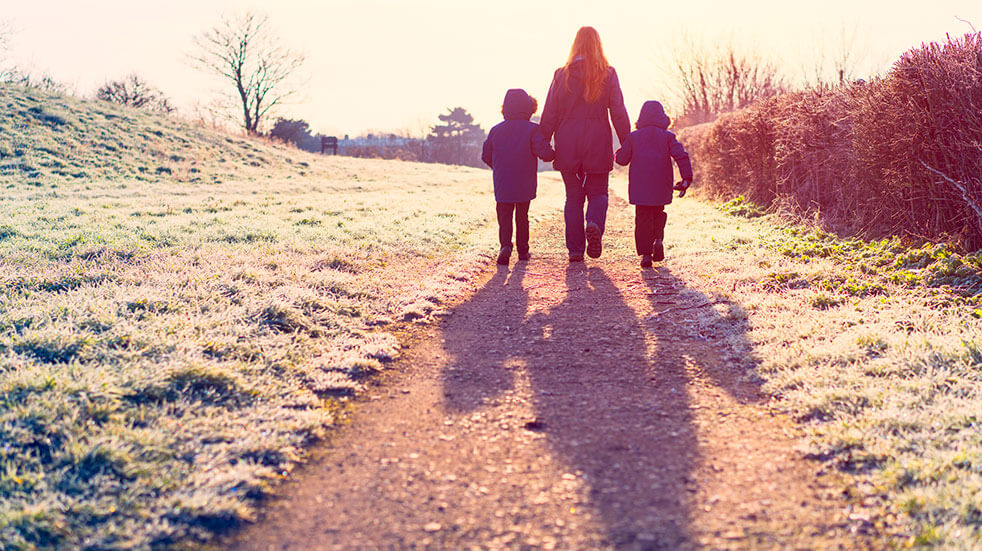 The Ramblers' Winter Walking Festival: mum and kids walking on a frosty day