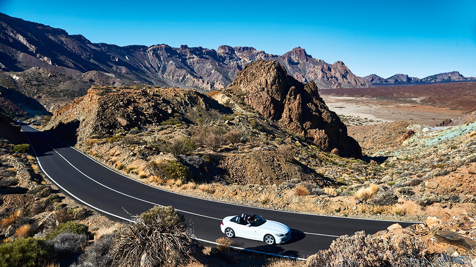 Self drive holiday in Tenerife: BMW Z4 driving past volcano