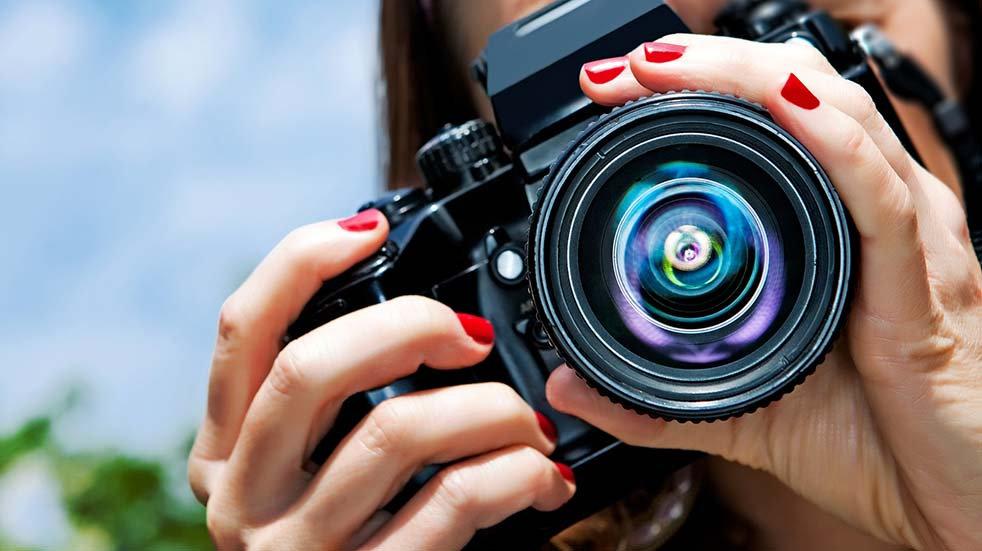 Send us your photography and you could win a prize woman with camera
