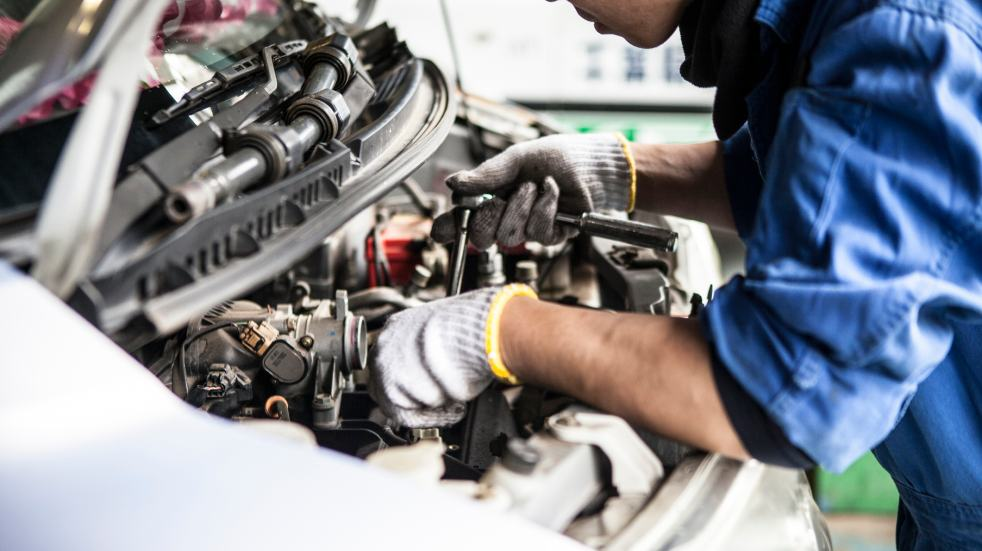 Should you buy a new or secondhand car car being serviced