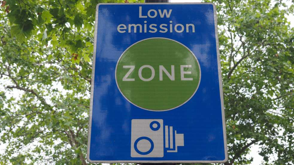 Should you buy a new or secondhand car low emission zone sign