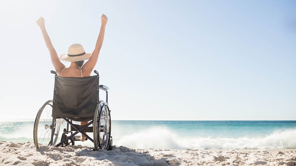 Six of the best European travel destinations woman in wheelchair on beach