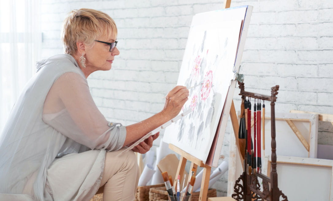Six ways to look after yourself in lockdown; woman painting