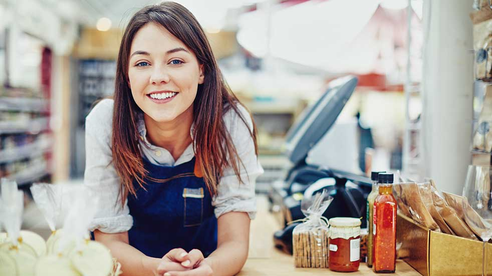 Small Business Saturday female shop owner smiling