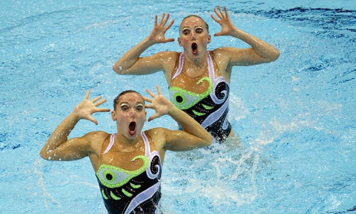 Two synchronised swimmers coming out of the water