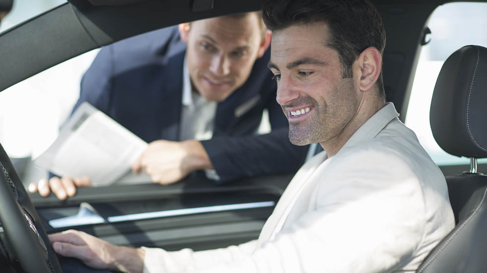 The best motoring deals for key workers man smiling in car