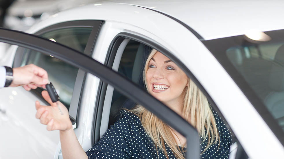 The best motoring deals for key workers woman smiling in car