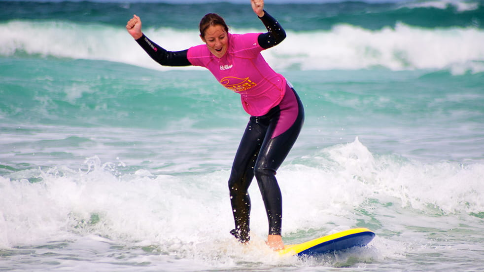 Family sports and fitness - surf lesson