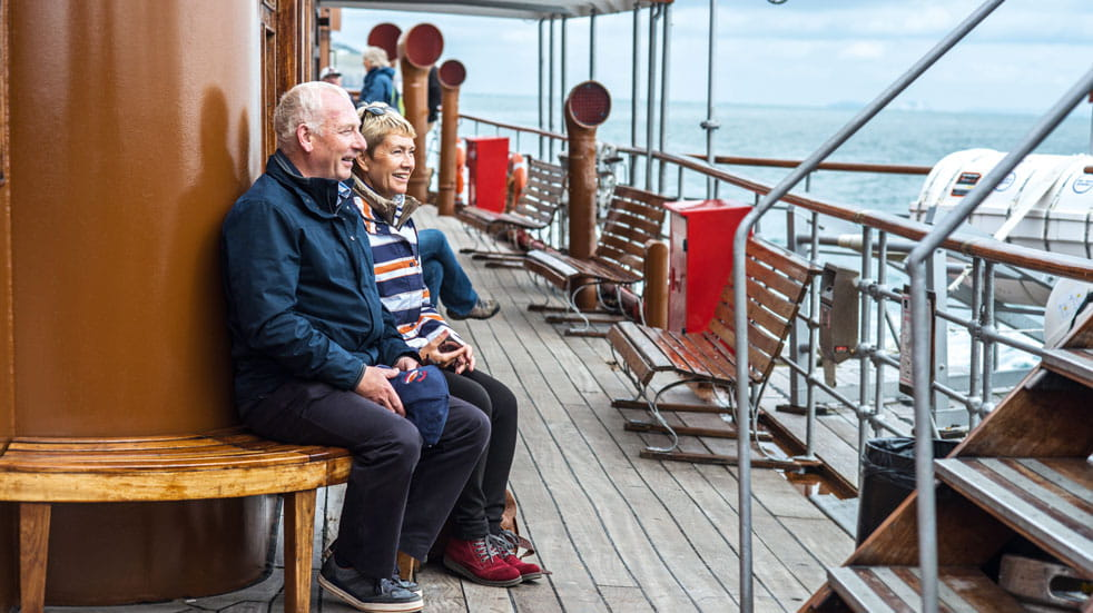 A couple enjoy a the view from the P.S Waverly steam ship