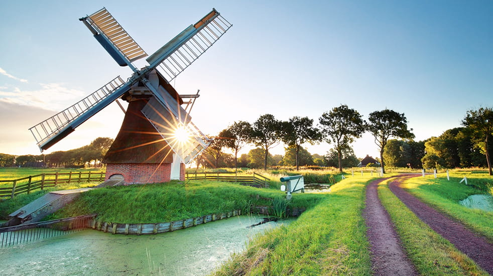 Why choose ferry travel to Europe: windmill in Holland