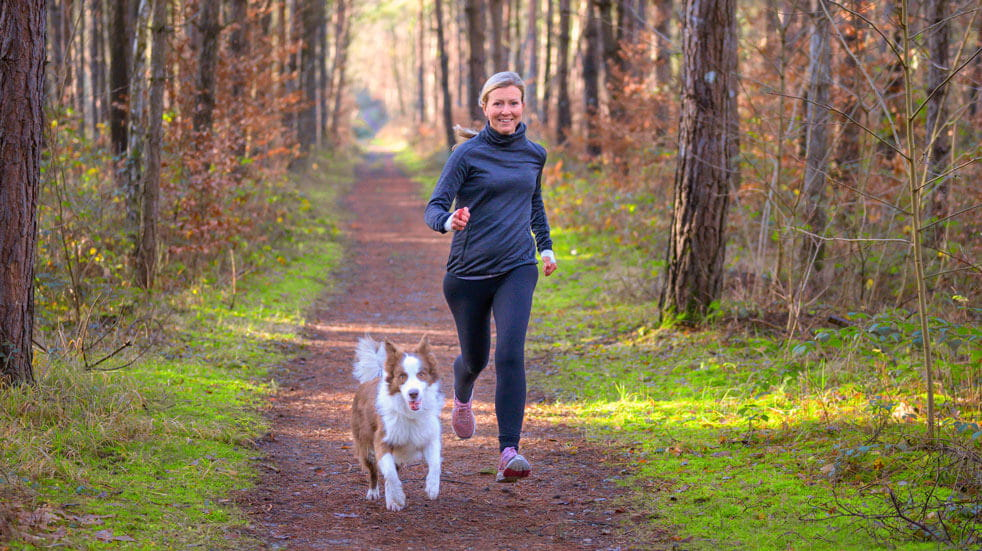 Why having pets at home could change your life; woman running with dog