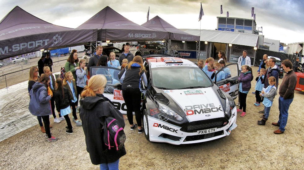 Vistitors viewing cars at the World Rally Championship