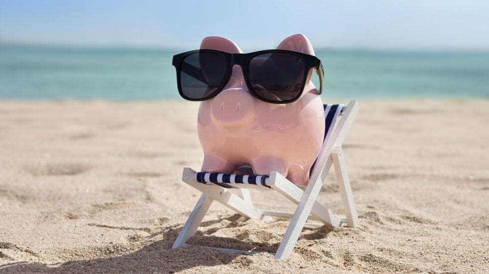 Piggy bank keeps money cool on the beach with some sunnies