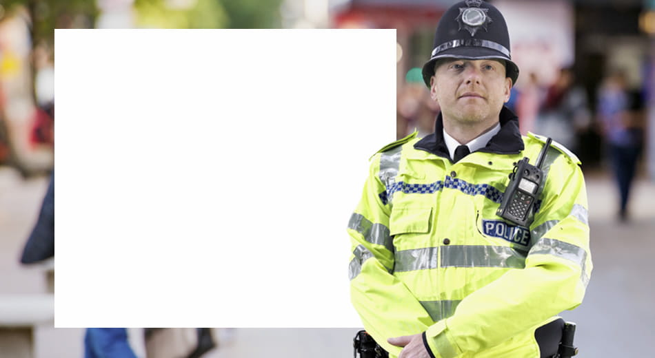 Policeman standing in shopping precinct