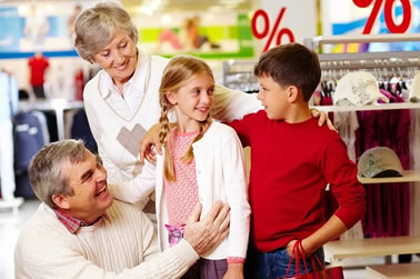 Children with grandparents shopping