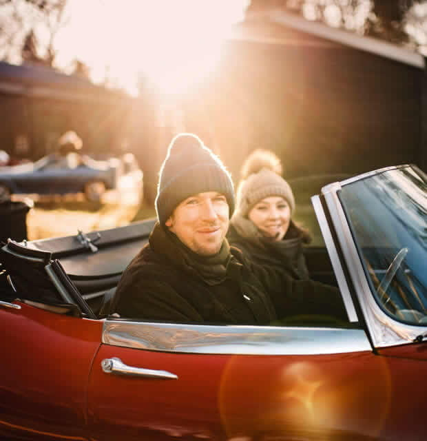 Couple in open top sports car