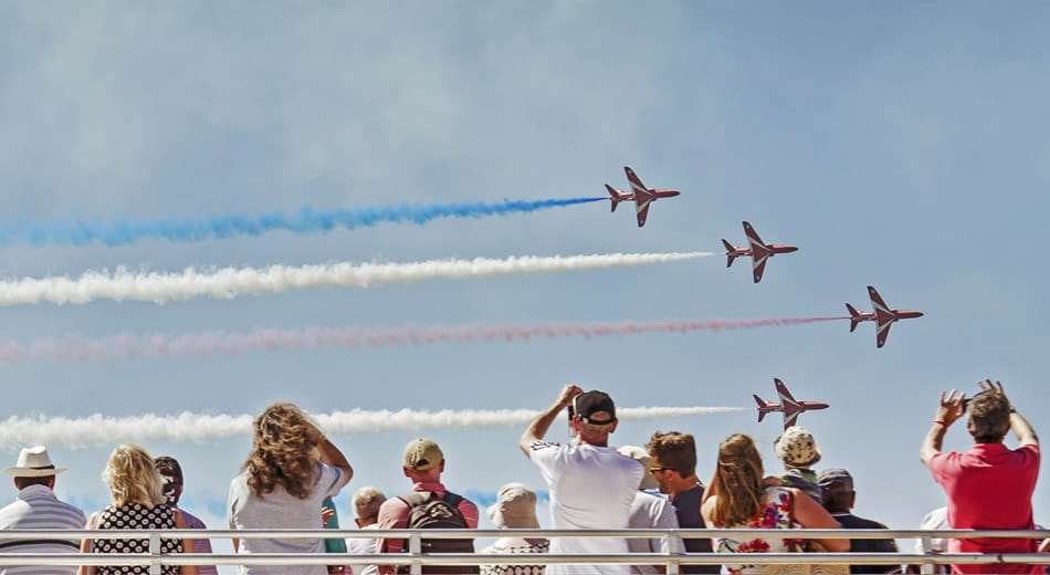 Crowds watching the red arrows