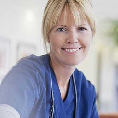 Smiling NHS worker