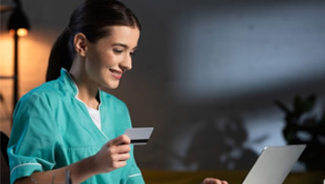nurse making a purchase on her card