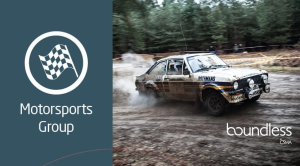 Rally car driving through mud for the Motorsports Group banner