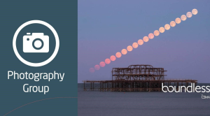 Time lapse image of a red moon over the West Pier Brighton for Photography Group banner