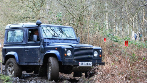 Side view of a 4x4 turning on a mud track