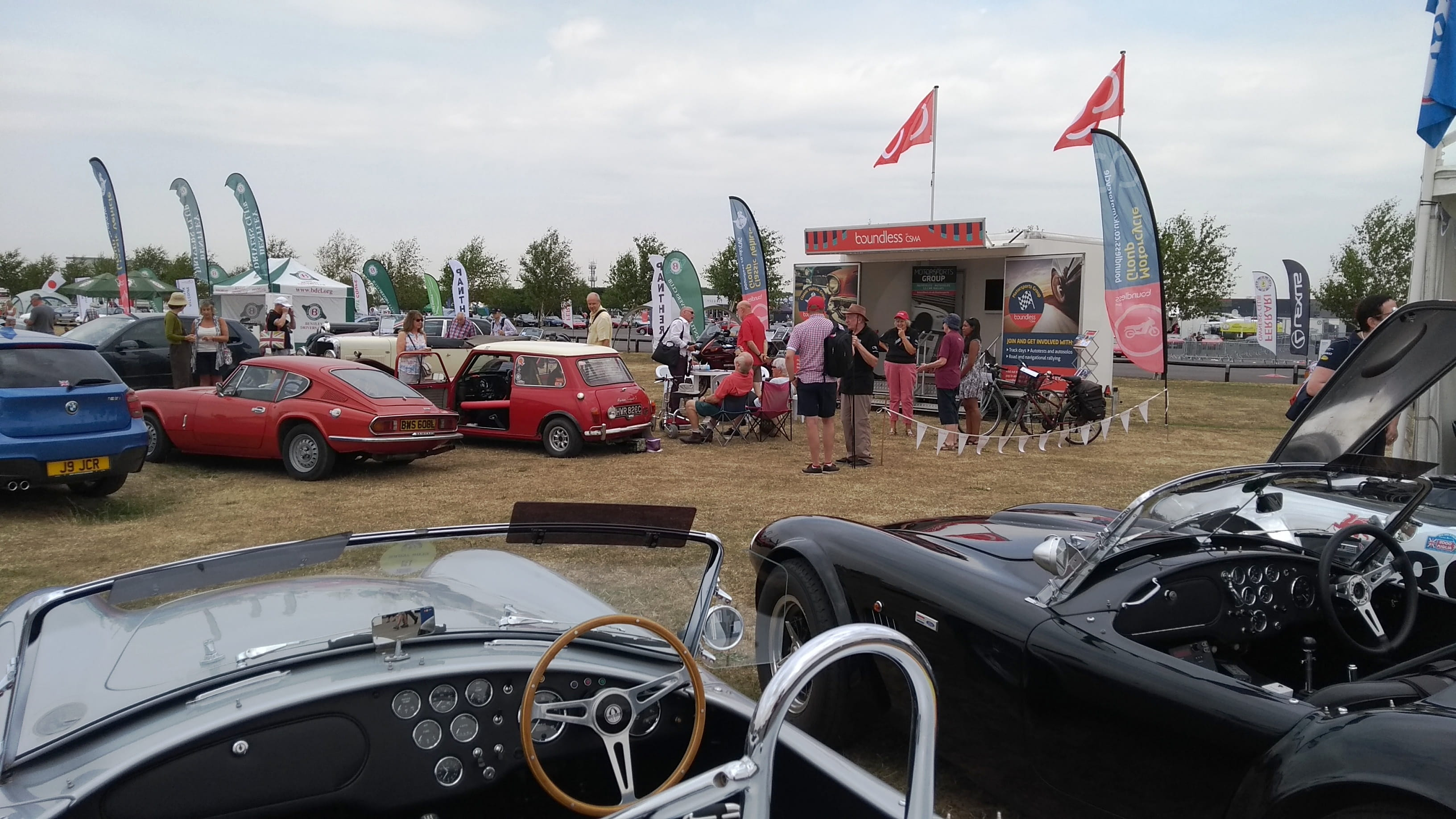Classic vehicle group display cars with Boundless flags in the background