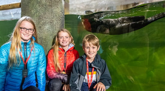 family with an otter