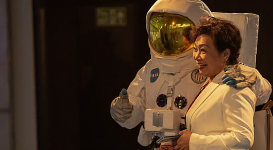 woman and an astronaut
