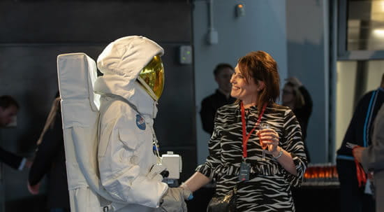 Woman greeting a spaceman
