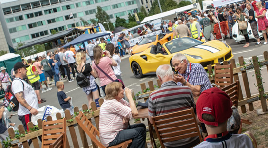 tellow sportcar with crowds