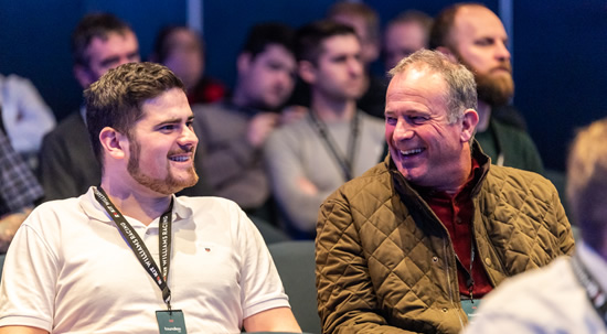 two men at Willams F1 event