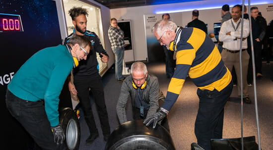 Boundless members changing a wheel